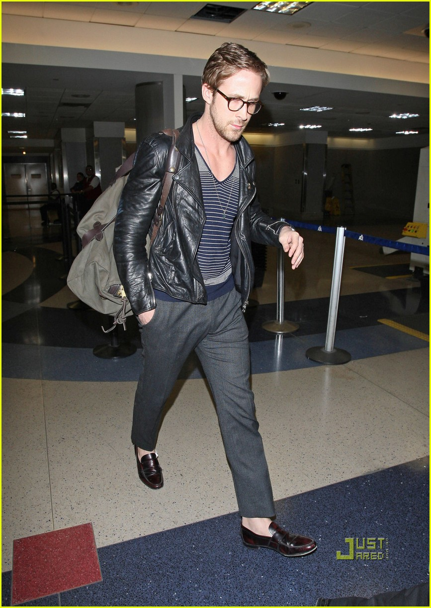 c448bd4cfe A sock-less A bespectacled Ryan Gosling touches down at LAX looking cool in  a leather jacket and grey slacks. Photograph  Matt Smith Jeff Steinberg