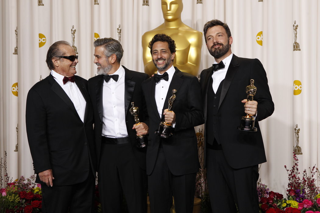 Jack Nicholson with winners George Clooney, Grant Heslov and Ben Affleck in the press room at the 85th Academy Awards.
